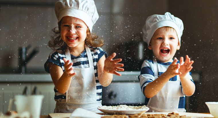 two children baking